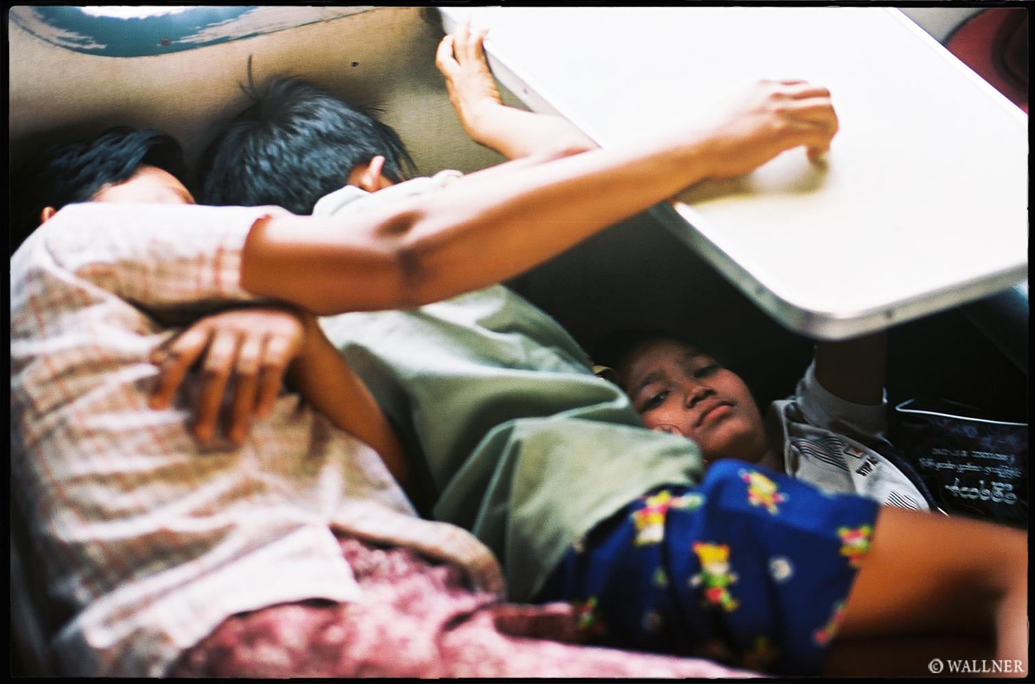 35mmPatrikWallner_Mandalay_SleepingUnderTableLOWQ